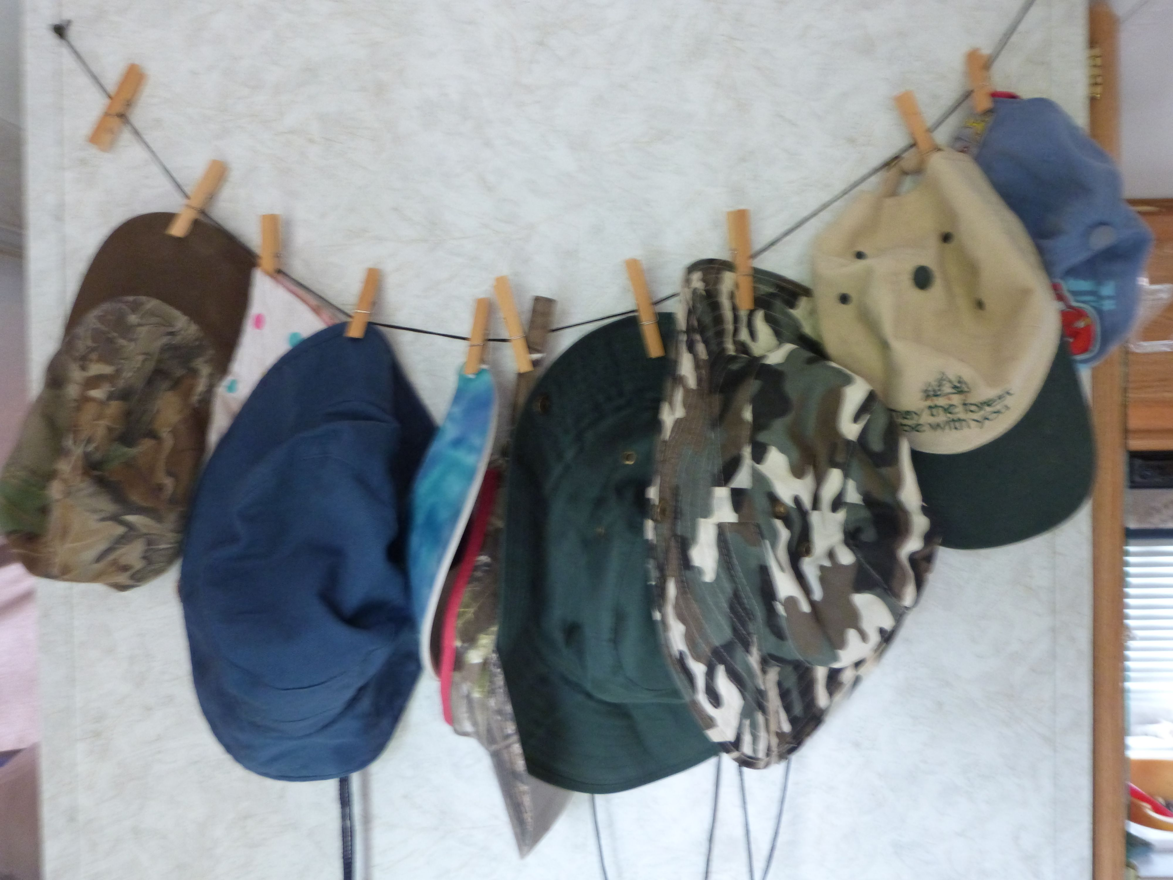 Hat organizer in our rv string stretched between 2 screws
