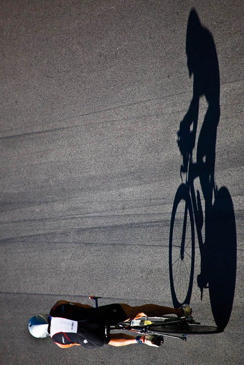 The shadow in this image makes the image so big and strong. It brings through more emotions, and when i view this i am draw to how big the rider seems on the bike and how that is how he could feel in that moment. It is a great way of shooting at a different angle, and bringing something different to sports photography