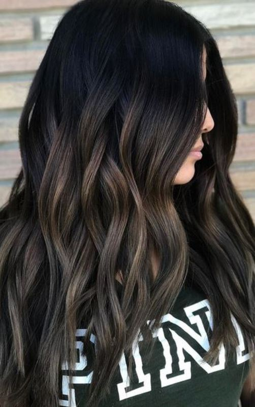 Smokey Brunette This Lady Is Having A Natural Looking Long Wavy Ha Hair Color Ideas For Brunettes Balayage Fall Hair Color For Brunettes Black Hair Balayage