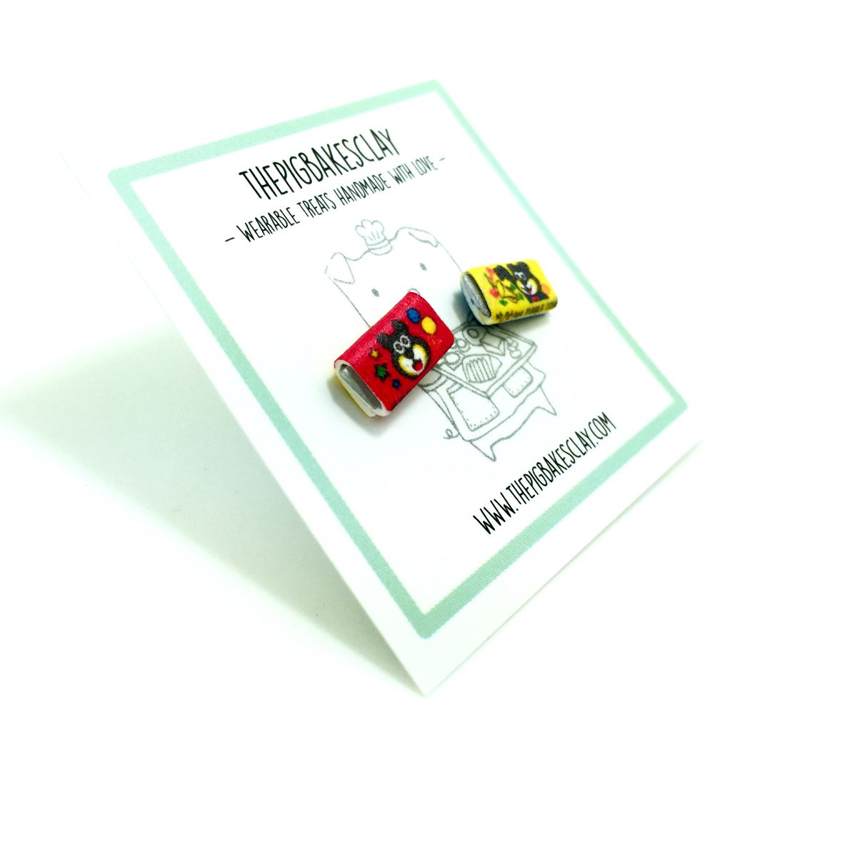 How I miss the tattoo that comes on the inside of the bubblegum paper! If you can't eat them(in SG), wear them!=P  Measurements Across: 1.1cm   Height: 0.6cm  Material This pair of miniatures are made of polymer clay and sit on nickel-free titanium steel studs.