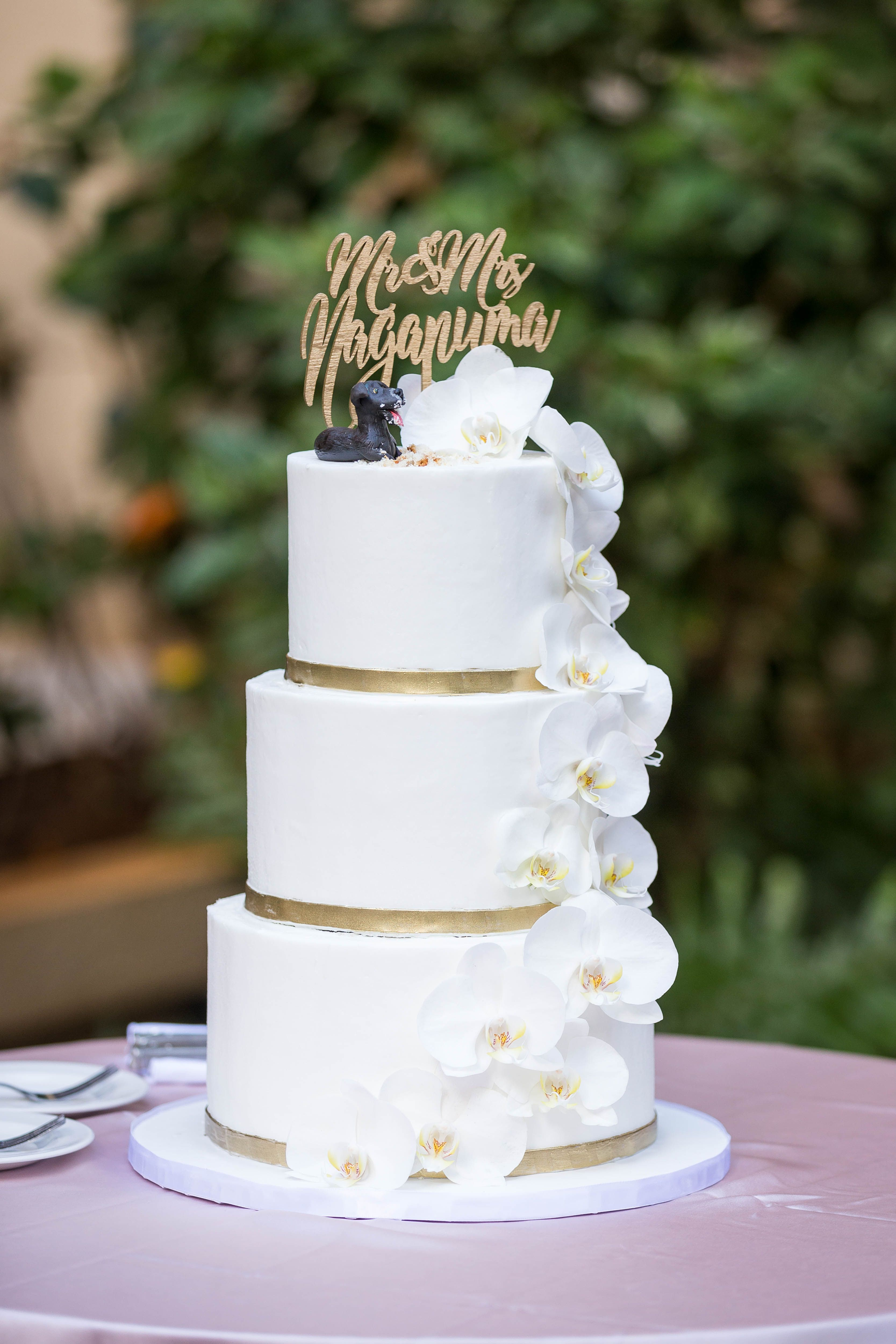 Elegant And Simple White Wedding Cake With Gold Bands And Orchids
