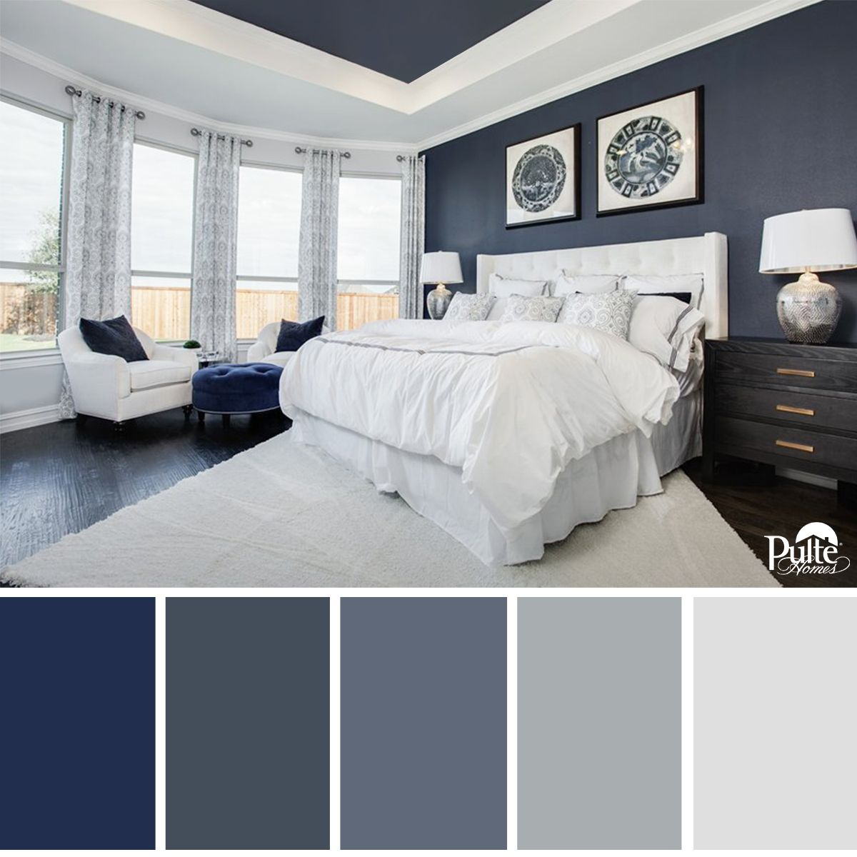 This bedroom design has the right idea the rich blue for Master bedroom interior paint ideas