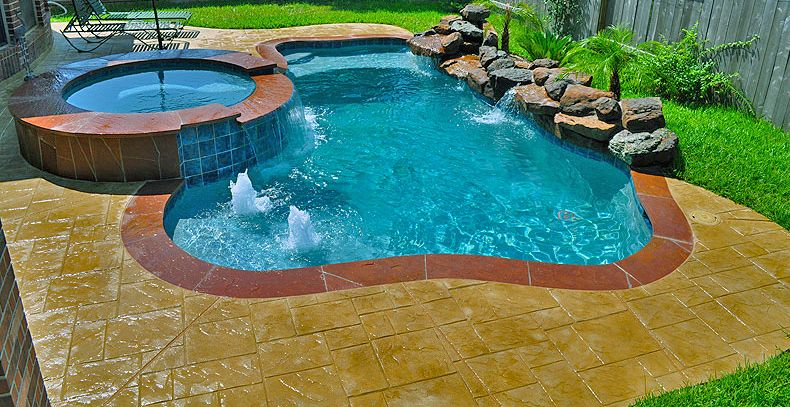 Small pool design with deck and water features. Tanning ledge ...