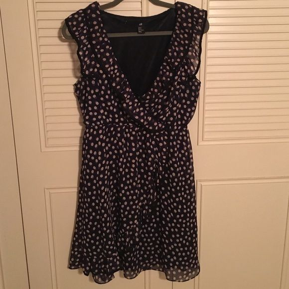 HM polka dot dress Cute and summery. Dark blue with tan polka dots, with a cute ruffle around the neck line H&M Dresses Mini