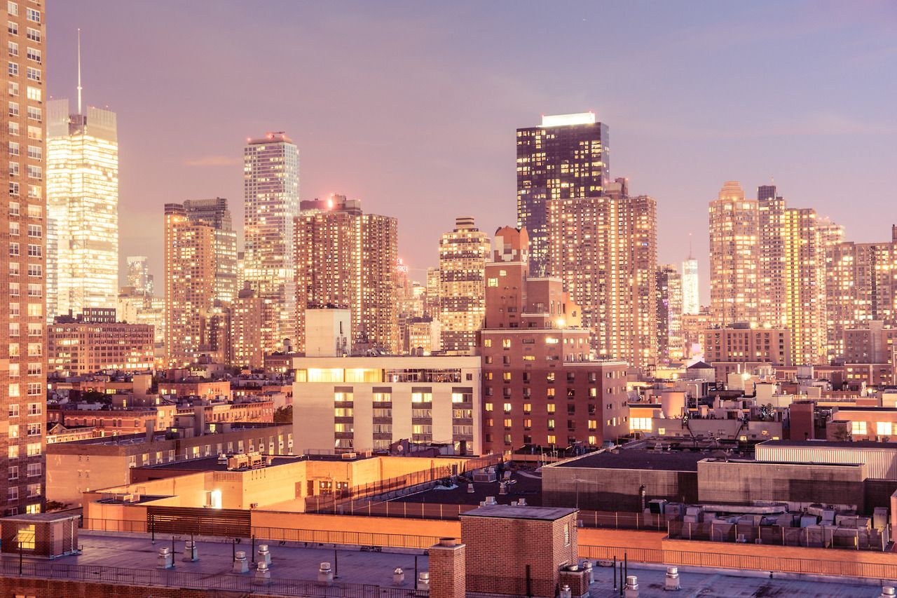 New York City Skyline Catch A View Of The Rooftops Of Midtown Manhattan While Standing On A Balcony In The Neighborhood Of New York New York City Nyc Skyline