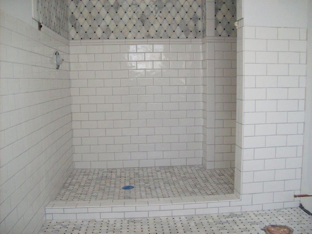 White subway tile with gray grout mixed with marble mosaic for Mosaic tile bathroom design