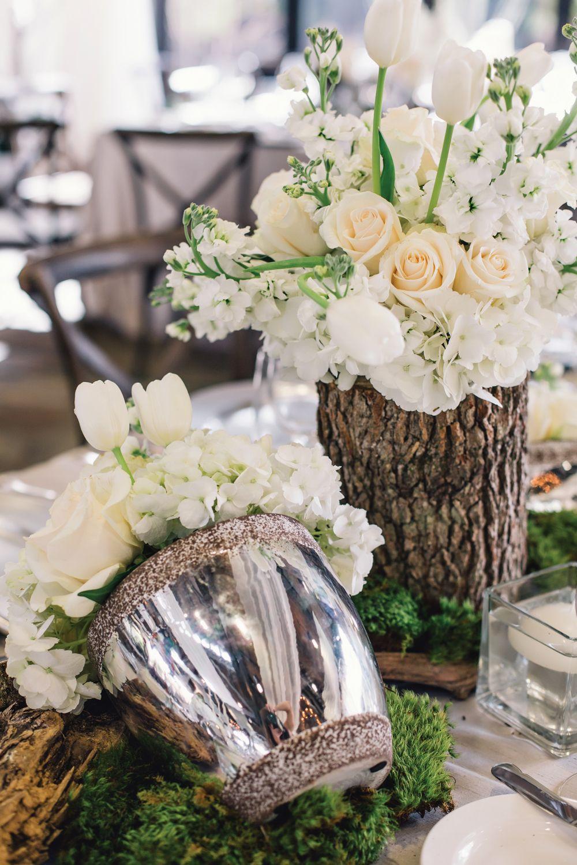 Wedding reception centerpiece of white flowers in silver