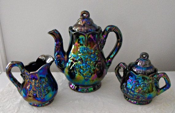 Vintage Rare and Unusual  1970s Iridescent Coffee or Tea Set with Covered Sugar and Cream Pitcher. $48.00, via Etsy.