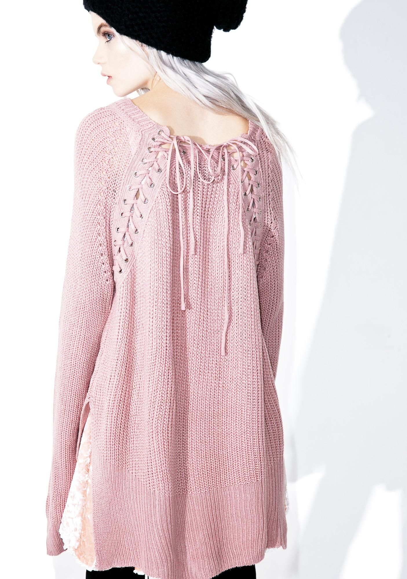 Romanticize Lace-Up Sweater cuz every time we see ya, dreams of our future together flash before our eyes… This sweet sweater features a comfy blush rib knit construction, slouchy oversized fit, rounded neckline, high-low cut, and lace-up detailing across the top of the back.
