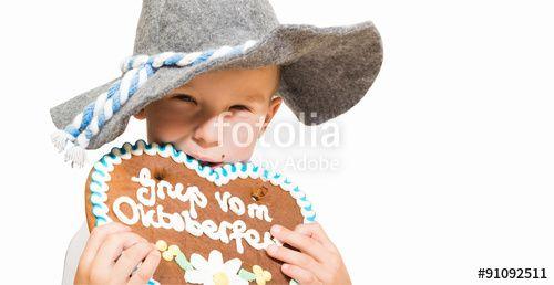 """Laden Sie das lizenzfreie Foto """"kleiner junge ist Oktoberfest brezel"""" von bg-pictures zum günstigen Preis auf Fotolia.com herunter. Stöbern Sie in unserer Bilddatenbank und finden Sie schnell das perfekte Stockfoto für Ihr Marketing-Projekt!"""