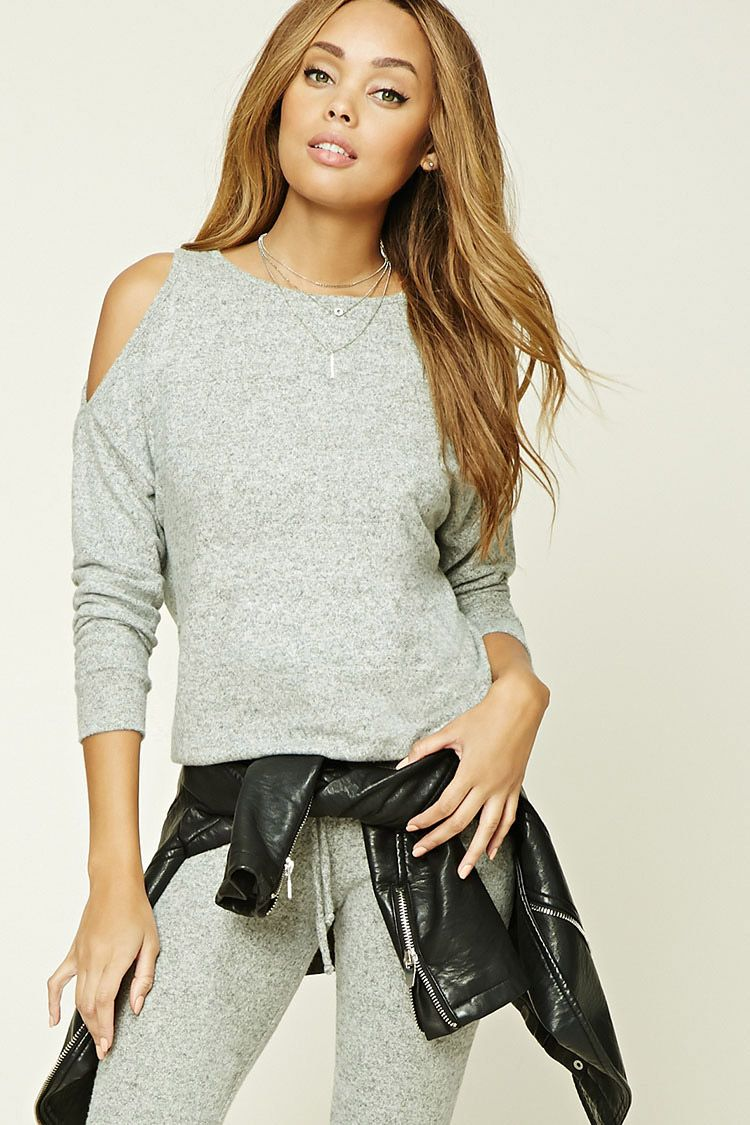A brushed knit top featuring long open-shoulder sleeves, a round ...