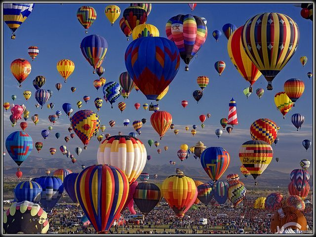 This balloon fest was in New Mexico, but we went to the one in El Paso. The desert sunrise over the mountains made for a gorgeous background. Maybe someday we'll go to the one in New Mexico :)