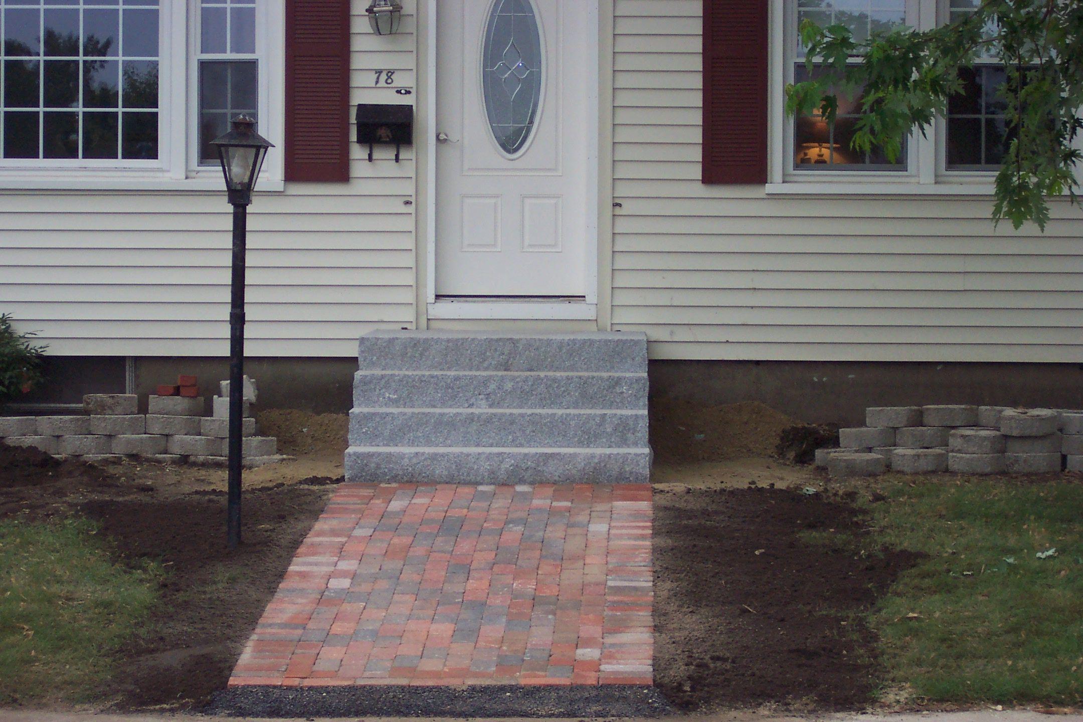 A Brick Walkway Leading To Granite Steps Makes For A Clean Look Brick Walkway Walkway Outdoor Decor