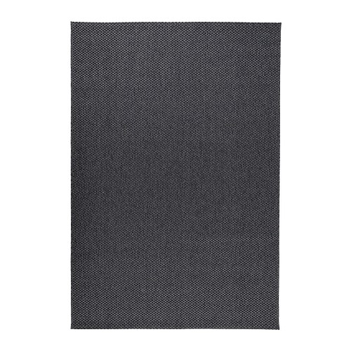 Jenn CordovaThis Rug Comes In Gray And Beige Is Easy To Clean Indoor