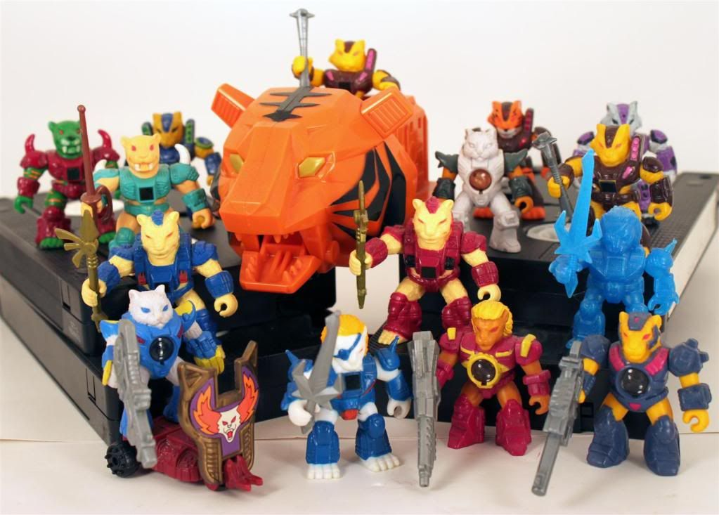 """A setup / display of several """"Battle Beasts"""" toys, with the Battling Tearn' Tiger chariot at the center of them all 
