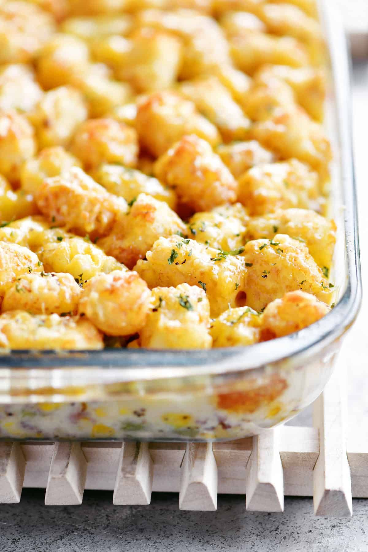 Tater Tot Casserole Has A Creamy Layer Of Ground Beef Italian Sausage Green Beans And Corn Toppe Tater Tot Casserole Ground Sausage Recipes Tater Tot Recipes