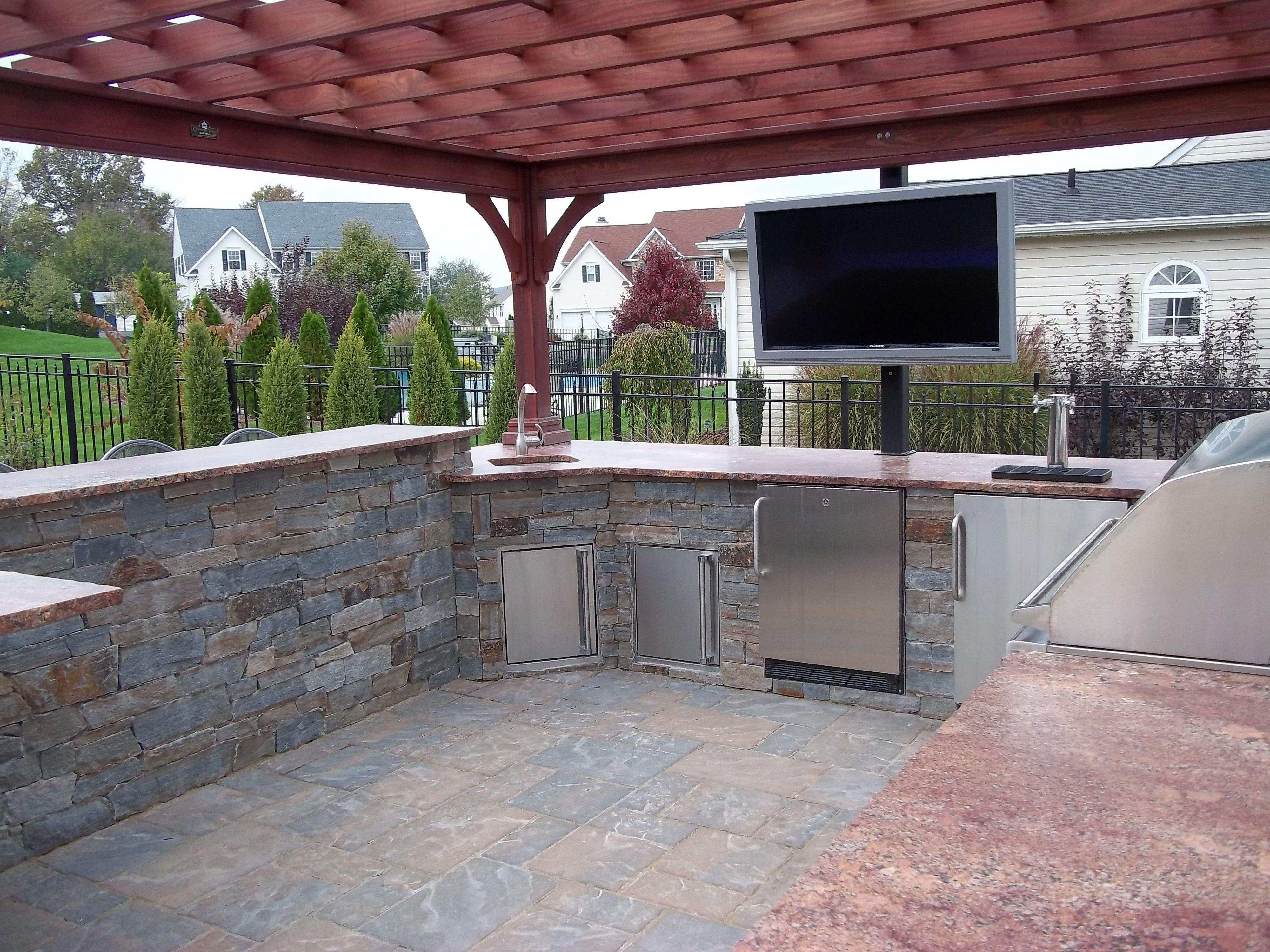 outdoor kitchen grill fridge beer tap and outdoor tv