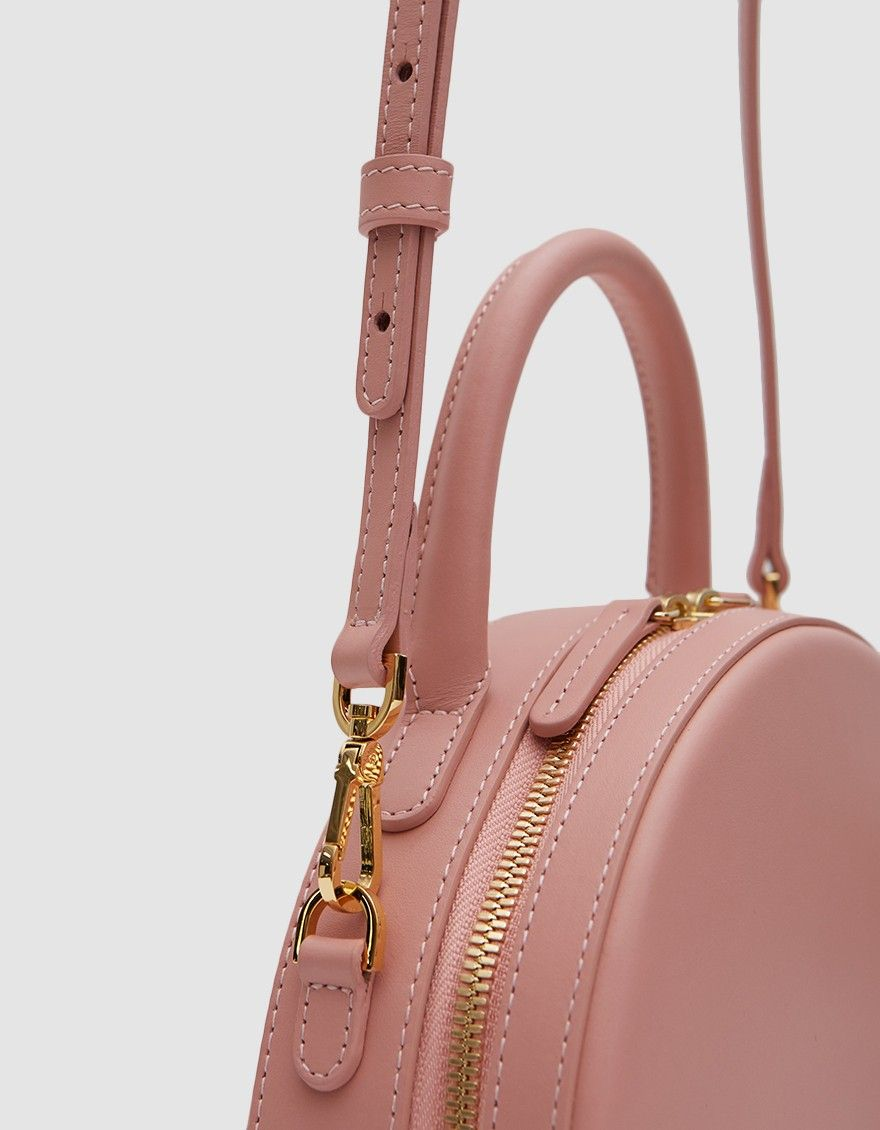 bb1aefe59de7 Structured circle bag from Mansur Gavriel in Coral. Calf leather. Top  handle. Main compartment with two-way zip closure. Two interior pockets.