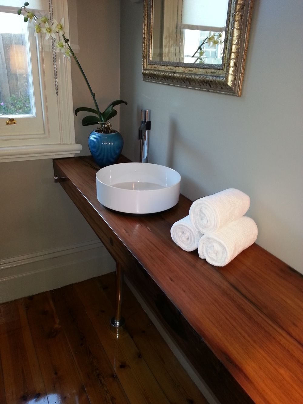 Bathroom Sinks Brisbane custom timber vanity made from a solid jarrah slab