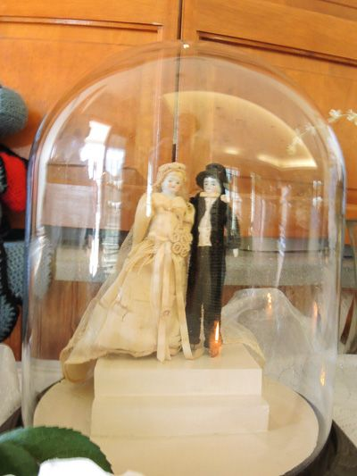 Include a family heirloom at your wedding like this grandparents' wedding cake topper from 1940 - http://ncweddingministerblog.blogspot.com/2012/11/mary-and-mark-have-heartfelt-wedding-at.html
