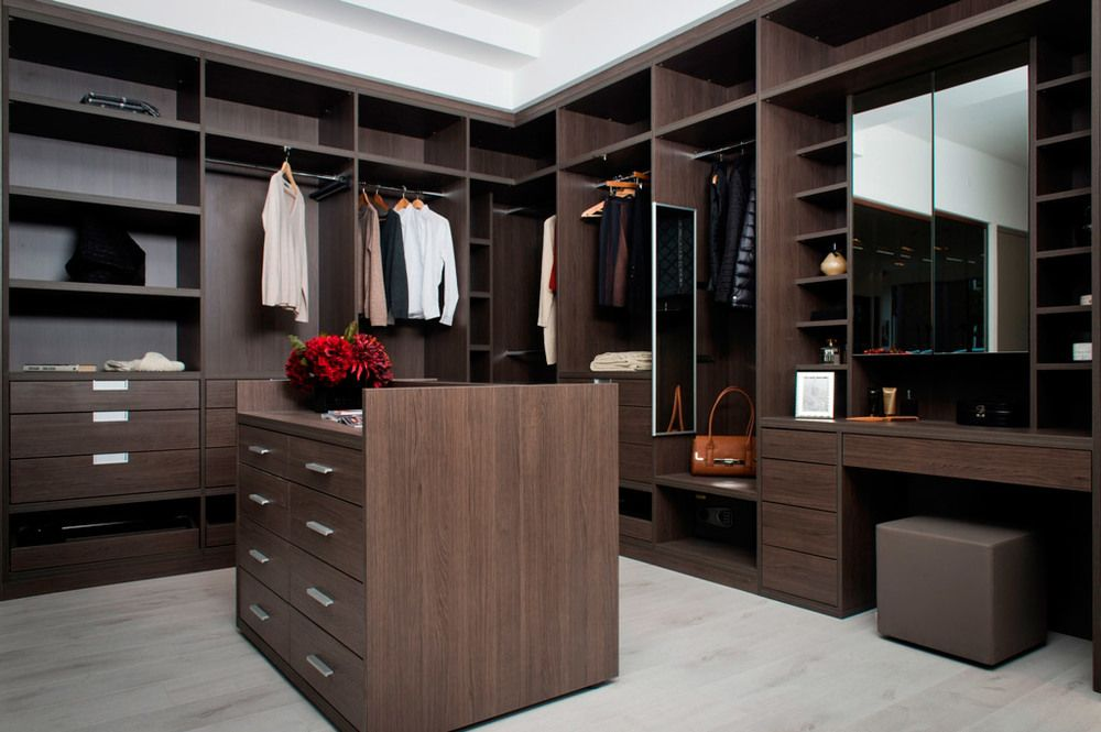 why not feature a bespoke island in your walkin wardrobe who want the addition of a builtin dressing table to their walk in wardrobe