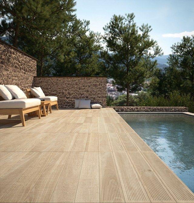 La calidez de la madera de manos del suelo porcel nico for Gres de breda para piscinas