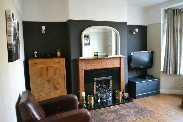 Dark wall dining room chimney breast dining room for Black feature wall living room