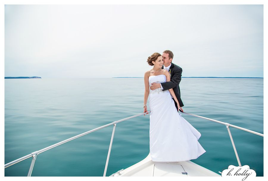 beautiful wedding photo on a boat kholly traverse city photographers