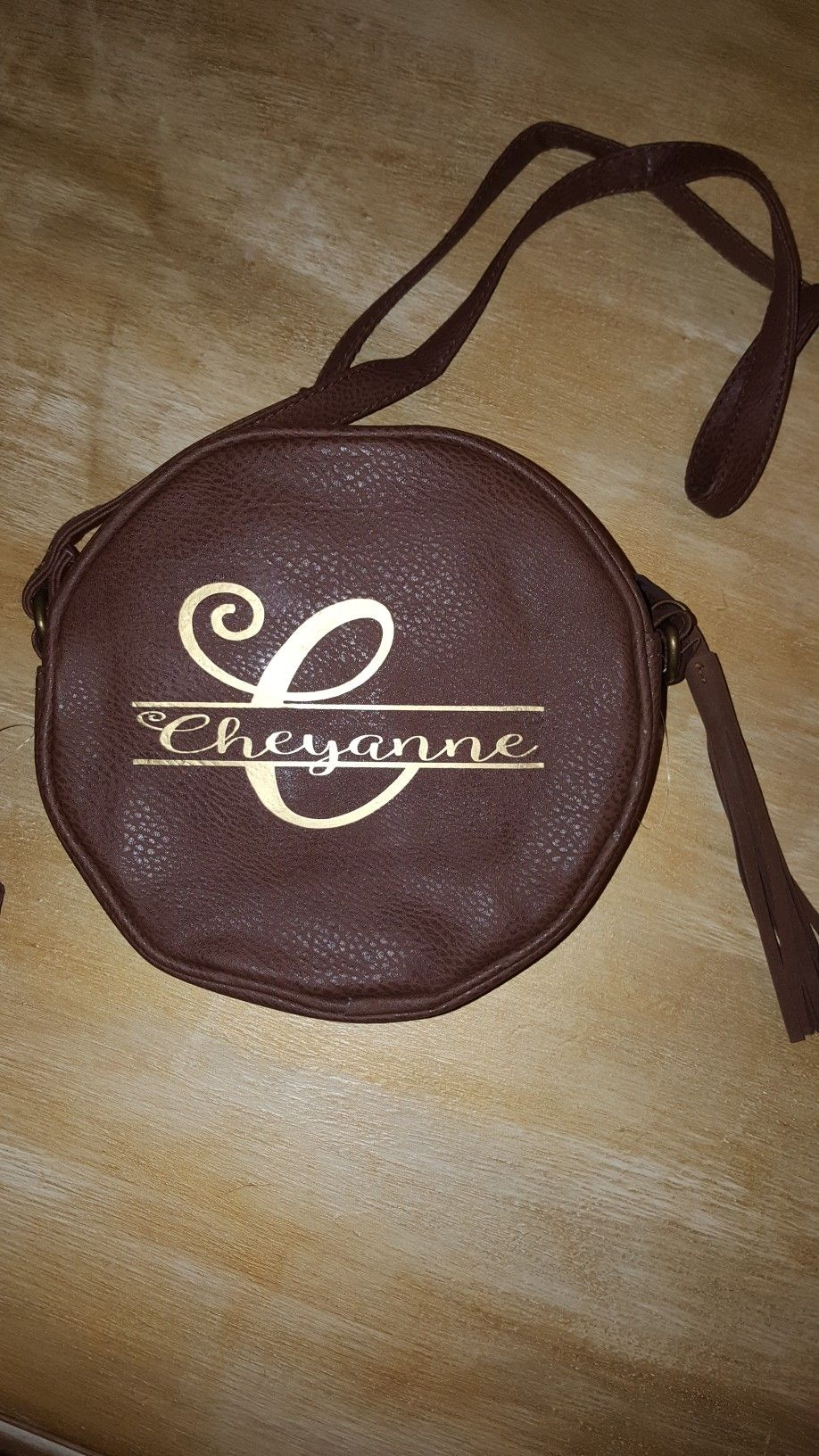 Split monogram on a pleather purse using gold vinyl