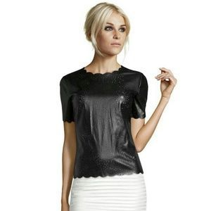 "I just discovered this while shopping on Poshmark: ""Celeb Style"" leather top. Check it out!  Size: M"