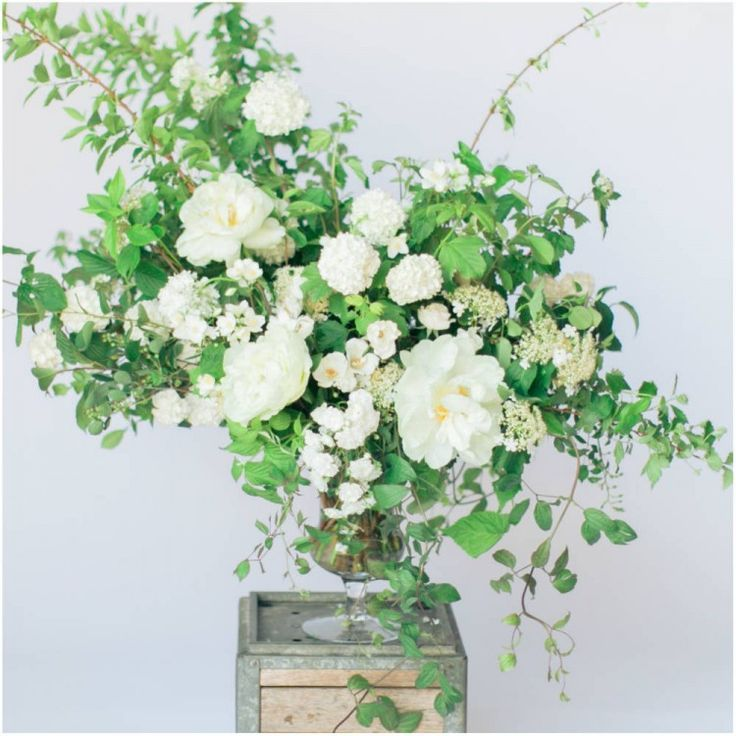 Floral Urns For Weddings: Two Urn Arrangements On Low Pedestals, At The Beginning Of