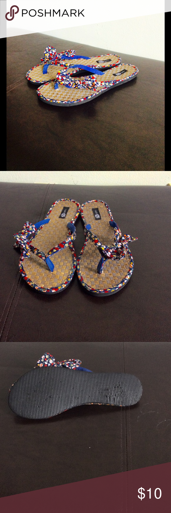 Floral Flip Flops Only worn a few times; the bottoms are a little scuffed up. Other than that, they're in perfect condition! Rue 21 Shoes Sandals