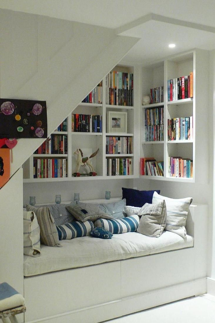 Cozy Reading Space Under The Staircase With Cozy Daybed And