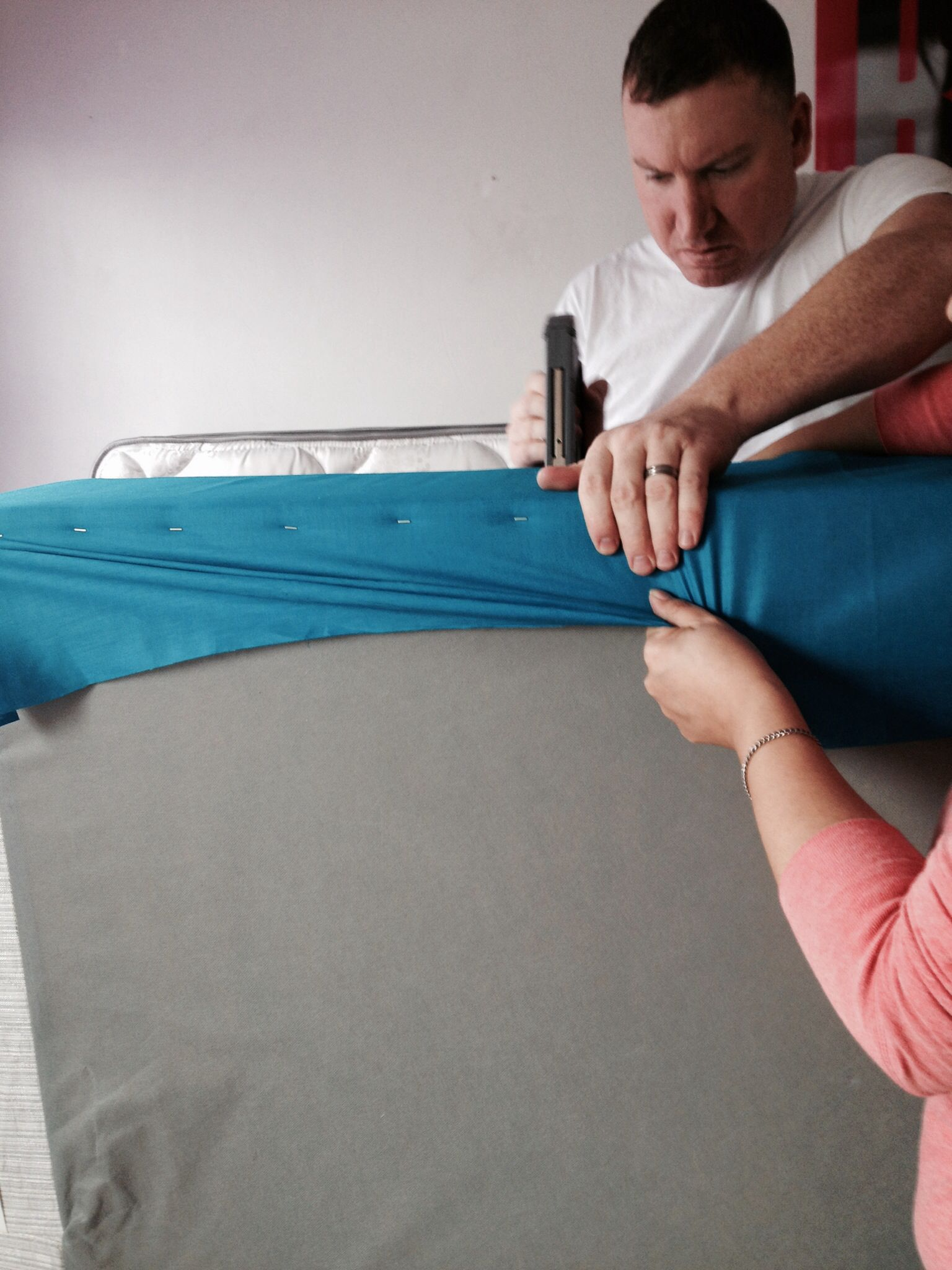9 - This part is a two person job. Make sure you pull the fabric tight while the other person staples it.