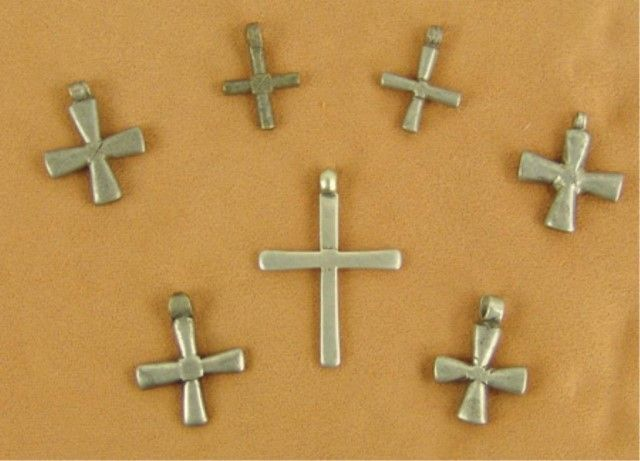 """Mid 1900s  Collection of seven hand wrought early Pueblo-style crosses made from coin silver. Very good condition.  Largest 2-1/4"""" x 1-1/2"""""""