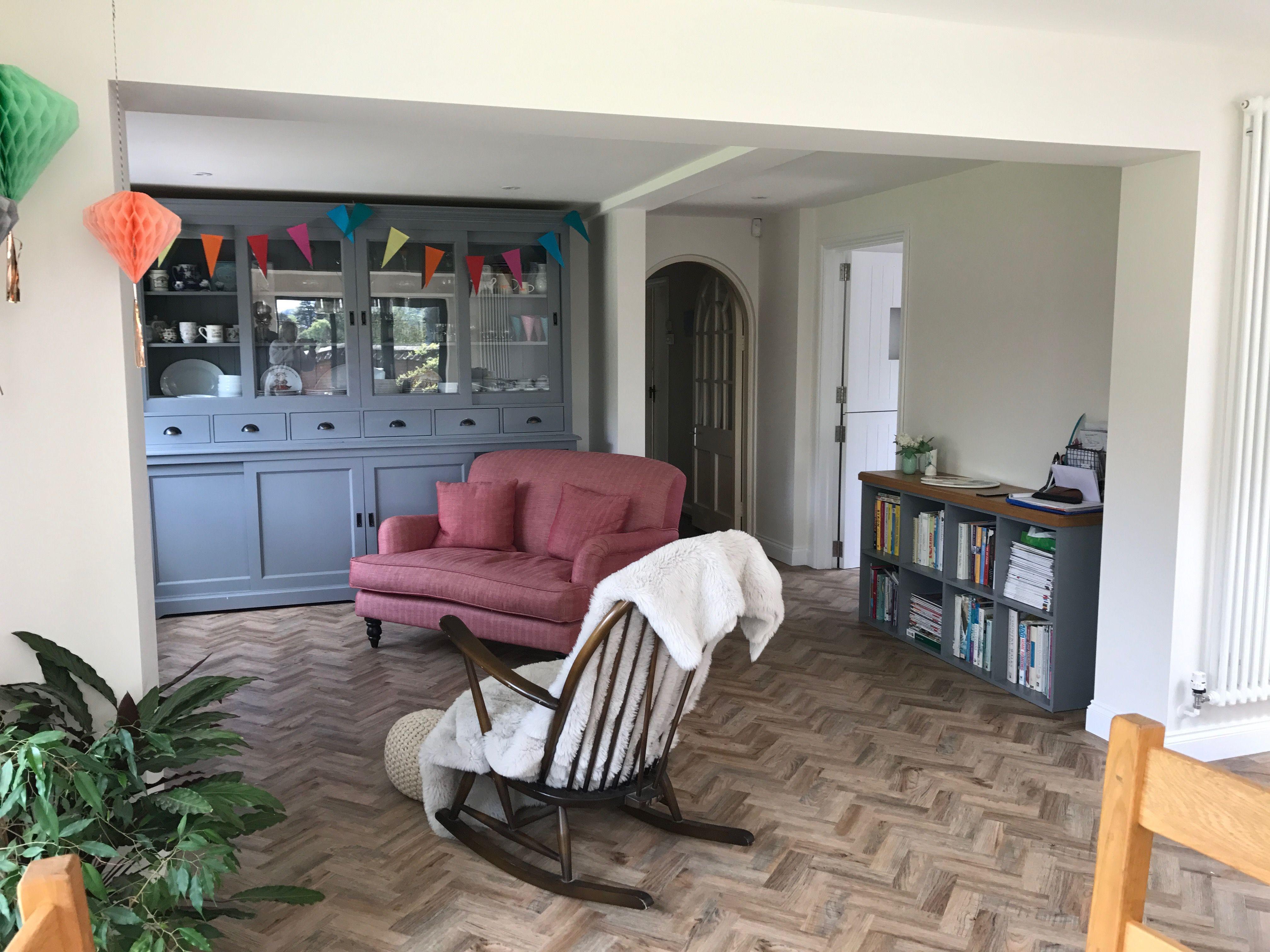 Herringbone floor, Grey Dresser, rocking Chair. Half of