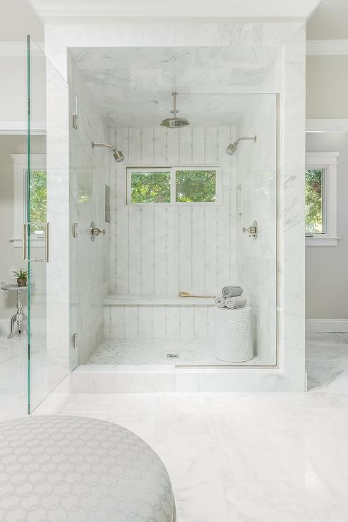 Fabulous master bathroom features a marble shower, placed in the