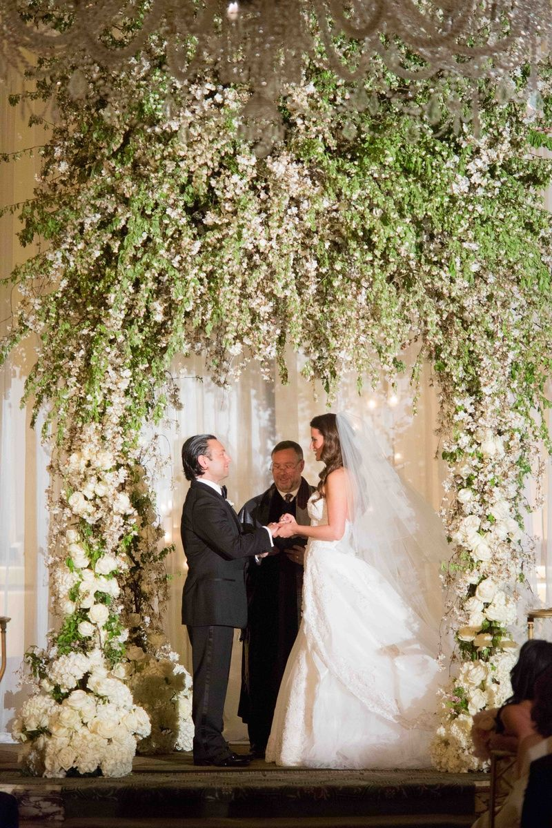 Towering Flower Arch    Photography: Roey Yohai Photography   Read More:  http://www.insideweddings.com/weddings/new-york-city-wedding-filled-with-opulent-decor-and-florals/544/