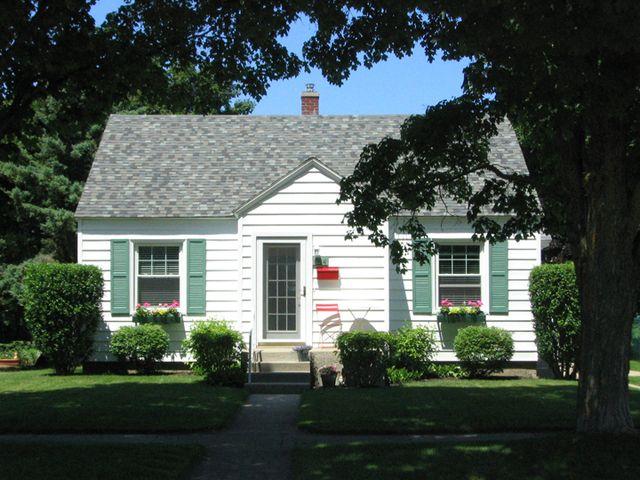 Michael S Laid Back Cottage Backyard Cottage White Exterior