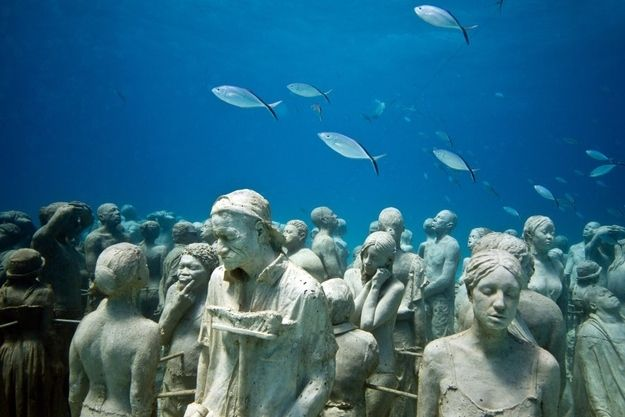 In 2006, diver and artist Jason de Caries Taylor discovered the world's first underwater sculpture park in Grenada. He then photographed the monument which is now part of the National Geographi...