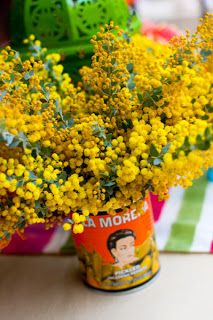 Party Frosting: Mexican Fiesta Party Ideas and Inspiration!  Shop the Latino aisle for vintage looking cans to use as vases.