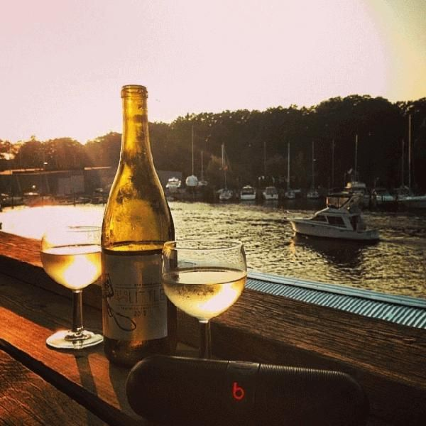 @ megal88 & @gimmedatbeckay enjoy a bottle of #wine on the deck overlooking Black River #Harbor at Downtown #SouthHaven's Old Harbor Inn! #happyhumpday #PureMichigan #relax