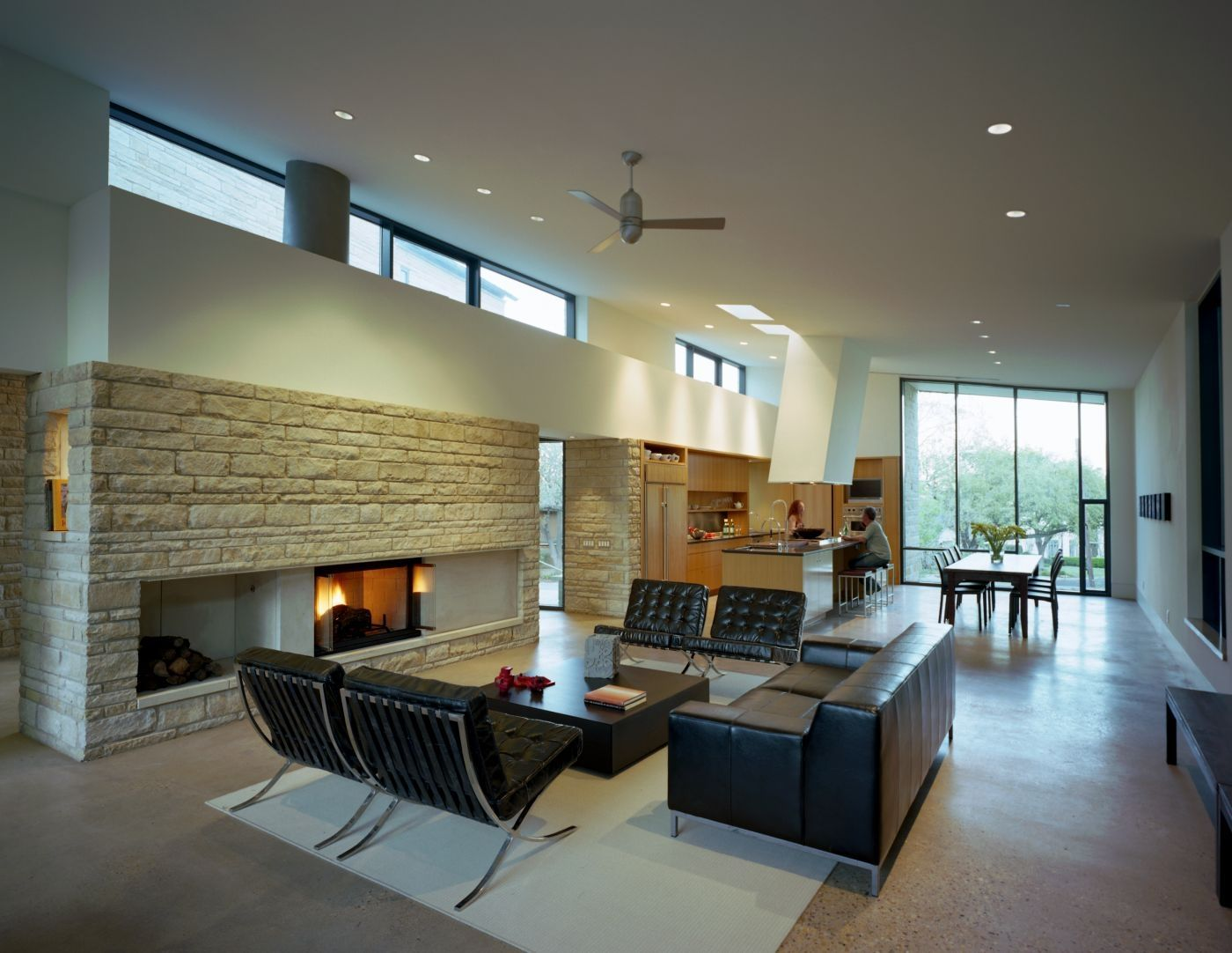 a stone wall beautifully complements the design of a living room