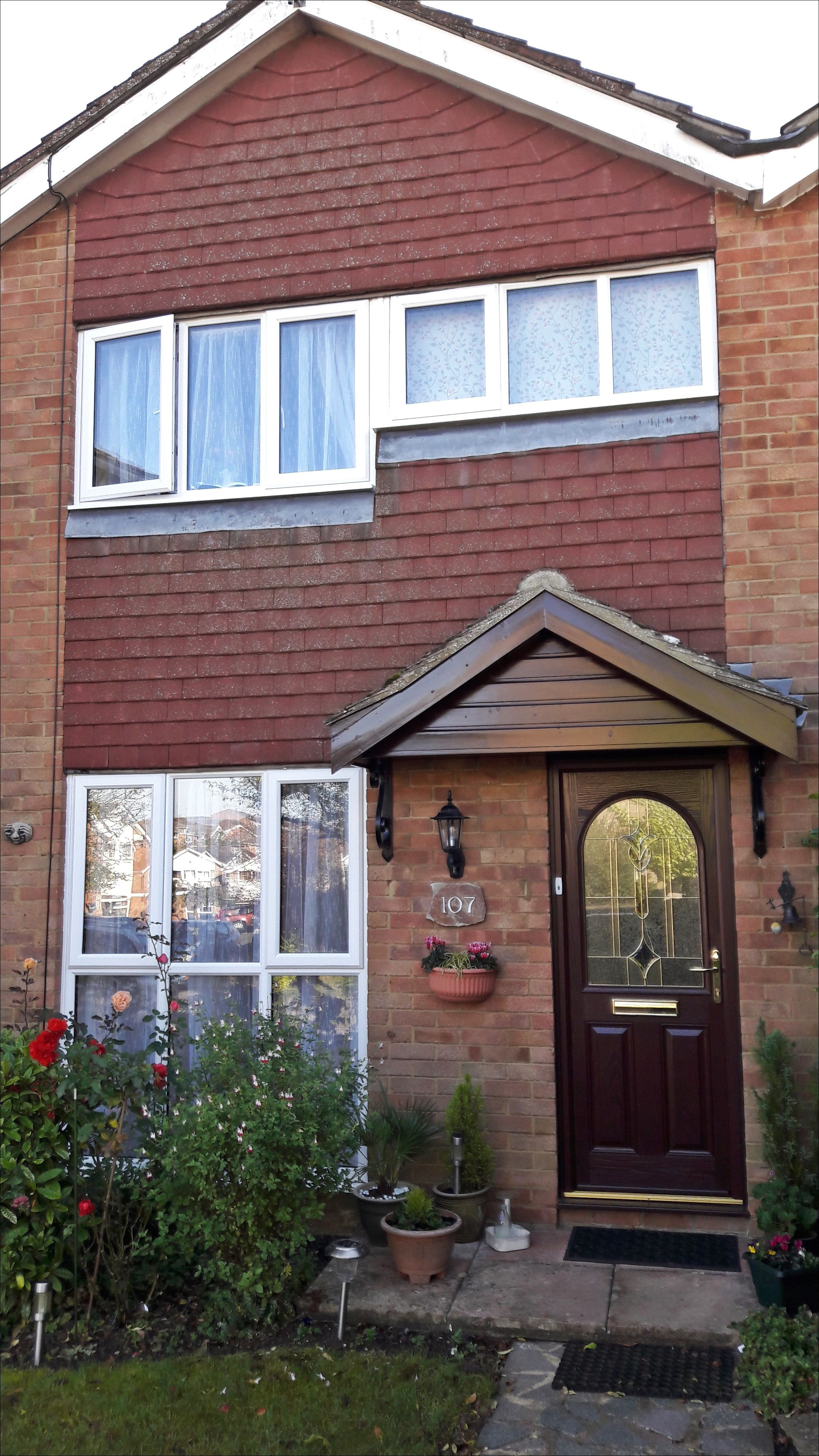 Rosewood Front Door With Gorgeous Glass Design And White Upvc