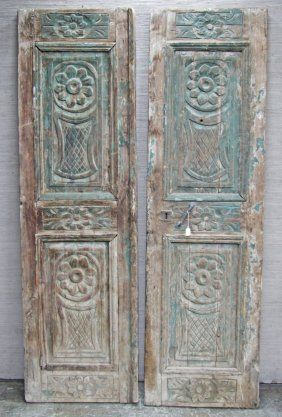 PAIR OF ARCHITECTURAL CARVED WOOD DOORS