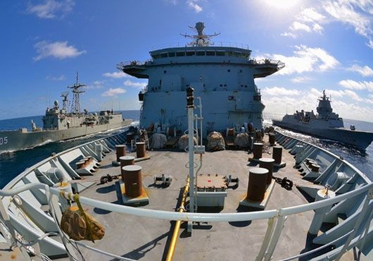 UK's Royal Fleet Auxiliary (RFA),Fort Victoria, simultaneously refueled Australian ship,HMAS Melbourne,& Norwegian,HNoMS Fridtjof Nansen, in balmy conditions off north-eastern coast of Somalia.Risky manoeuvre requires nerves of steel from each ship's captain & crew as vessels sail just metres apart while fuel transferred.Replenishment completed successfully,allowing Fort Victoria & Melbourne to continue counter-piracy mission in support of Combined Maritime Forces CTF-151.
