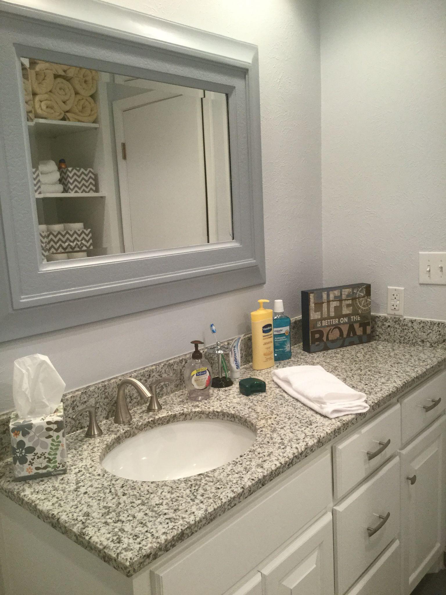 Open Cabinet Behind Door In Small Bathroom
