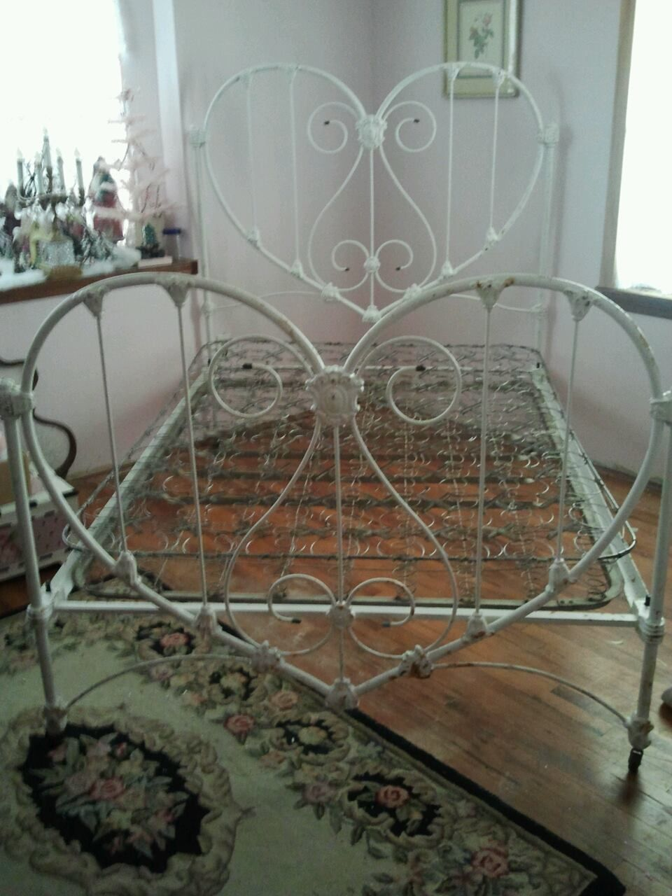 Well here it is my heart shaped antique iron bed for Bed spring decoration