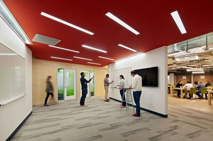 Brainstorming under red:  Inside SquareTrades San Francisco Offices