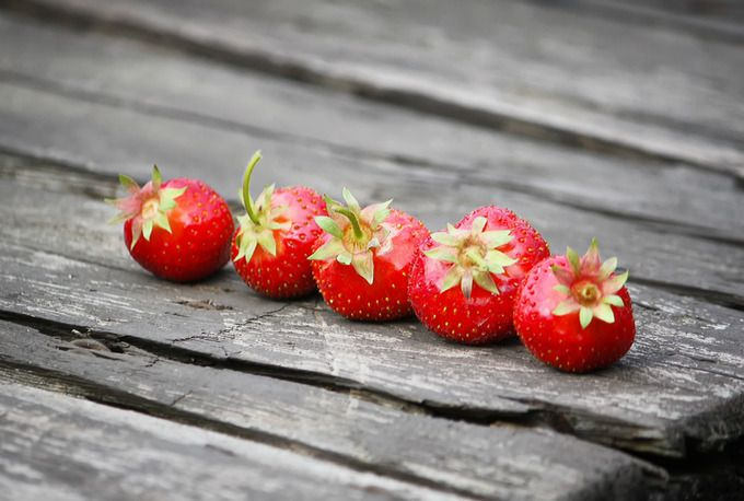 Strawberry on wooden table by Creating_Is_Happiness on Creative Market